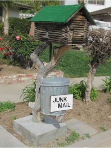 A Log Cabin Mailbox with a Junk Mail Trash Can